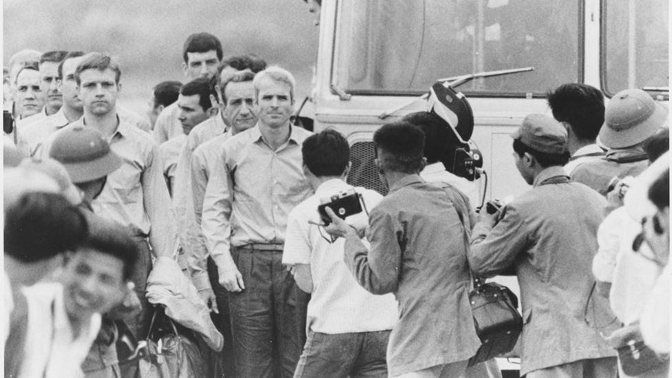 McCain waiting for the rest of the group to leave the bus at airport after being released as POW Record Group 428 General Records of the Department of the Navy, 1947-2004 Citation: 428-GX Box 262 N 11556665 Rediscovery #10473 10473 2007 001 John McCain After Being Released as Prisoner of War