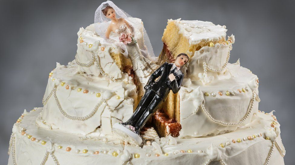 A wedding cake with a split down the middle