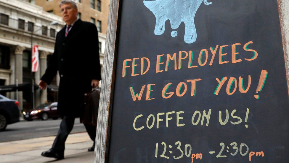"Sign reads: ""Fed employees we got you -- coffee on us"""