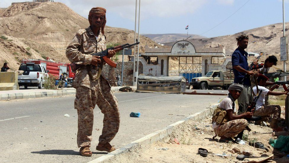 Yemeni soldiers stand guard outside security camp following suicide attack in port of Mukalla. 15 May 2016