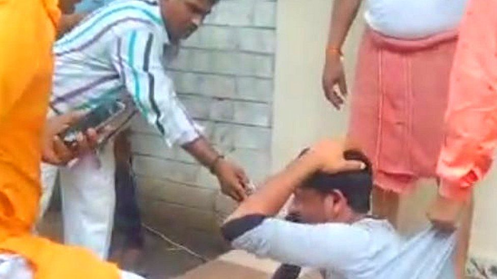 A screen grab of the viral video showing a bangle-seller being assaulted in Indore