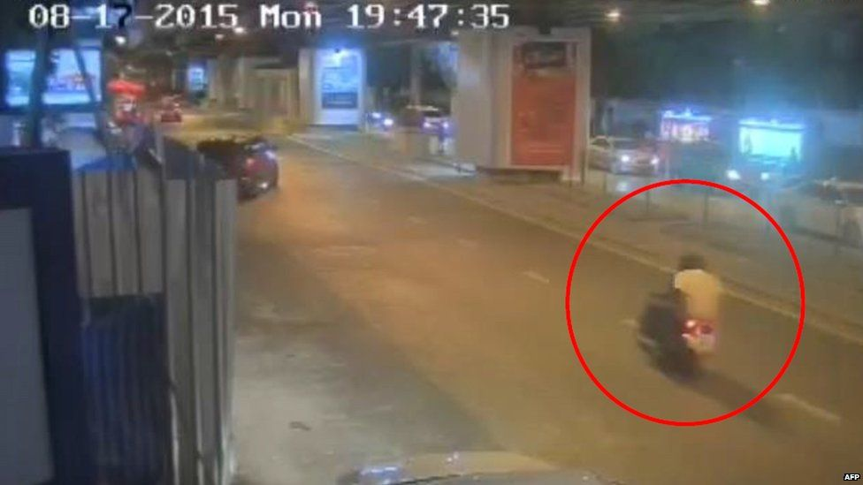 A CCTV image released by Thai police shows the main bombing suspect on the back of a motorbike, riding away from the shrine, just two minutes after a bomb was detonated