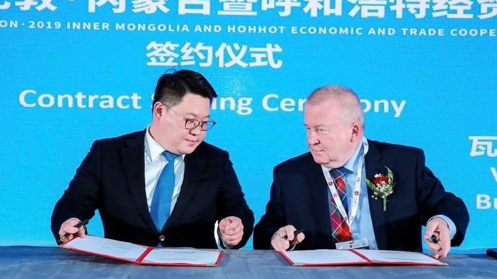 MengTai Group's Ao Fengting is pictured signing the distillery contract with David Valentine in London