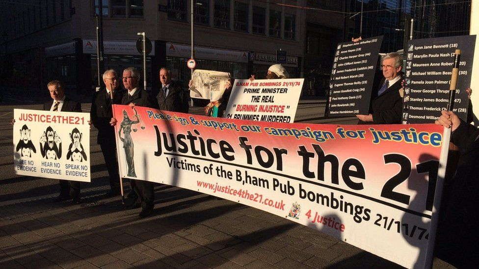 Birmingham pub bombing victims' families with banners