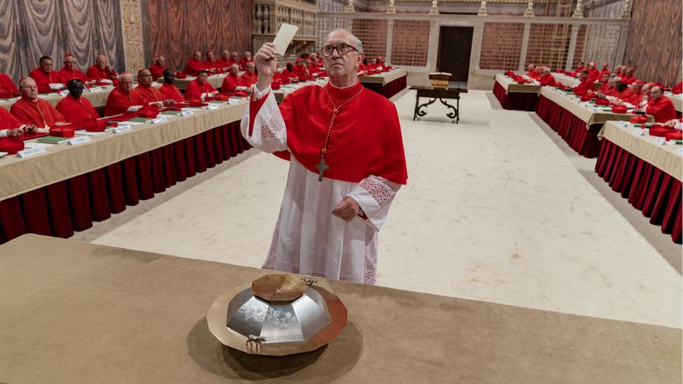 Jonathan Pryce as Cardinal Bergoglio casting his vote for the papacy