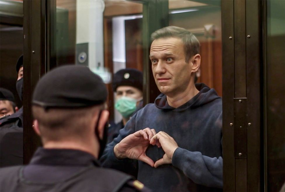 Russian opposition leader Alexei Navalny makes a gesture with his hands in the Moscow City Court, 2 February 2021