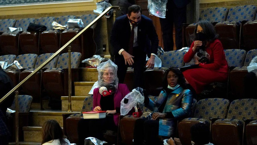 US lawmakers and staff wear protective gear amid protests inside the Capitol