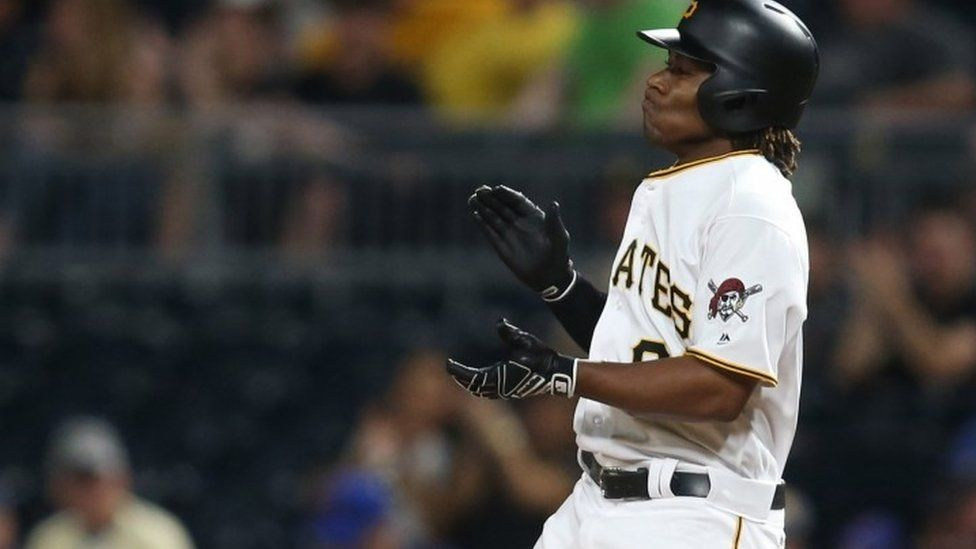 Pittsburgh Pirates second baseman Gift Ngoepe (61) reacts after recording his first major league hit against the Chicago Cubs