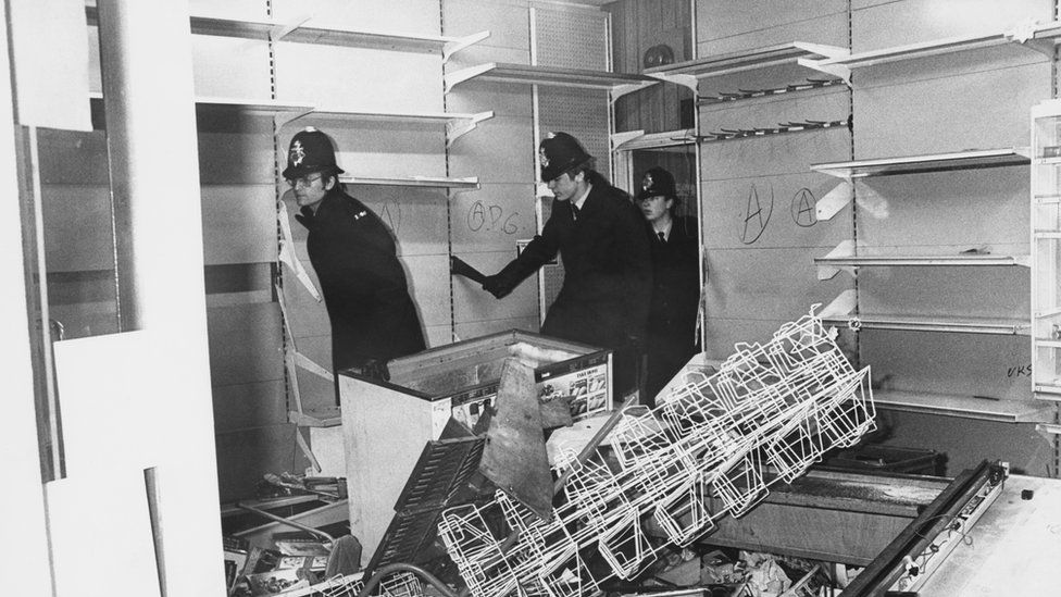 Police survey damage after riots