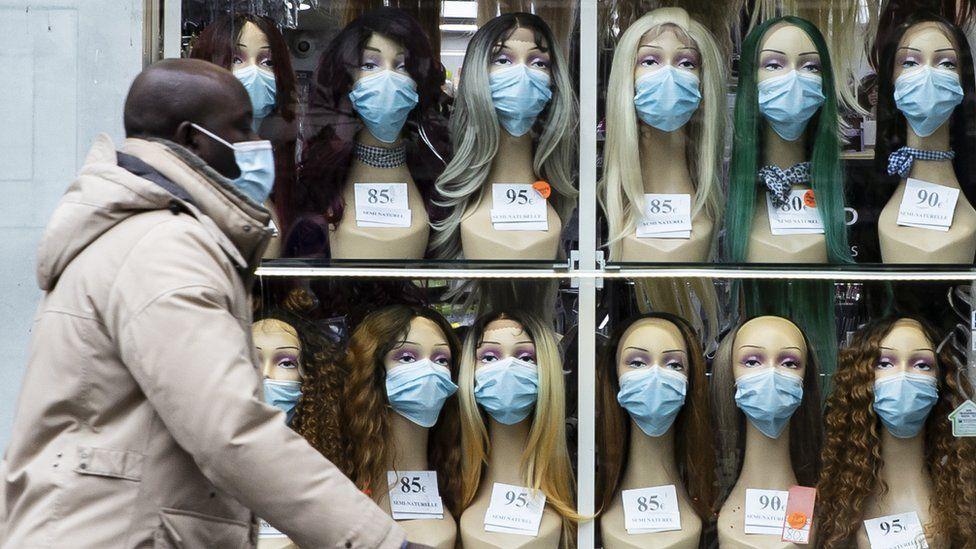 Masks on sale in a shop window, France