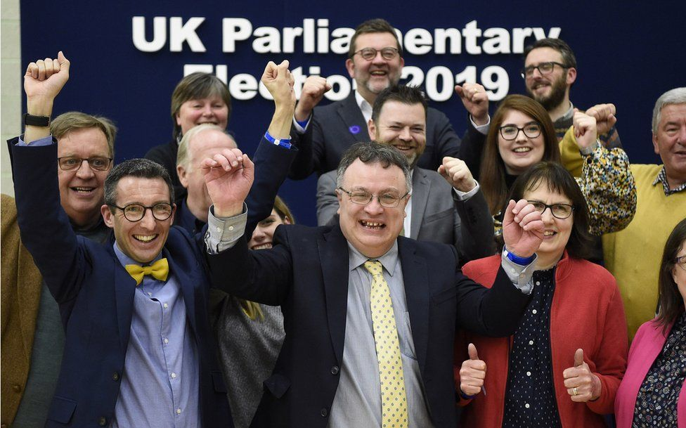 Stephen Farry celebrates with his Alliance Party colleagues