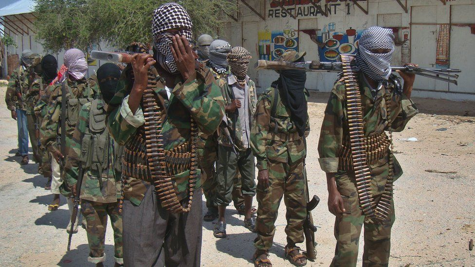 Al-Qaeda linked al-shabab recruits walk down a street on March 5, 2012 in the Deniile district of Somali capital, Mogadishu