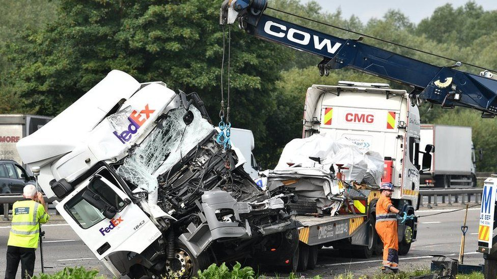 A lorry involved in the collision is towed away