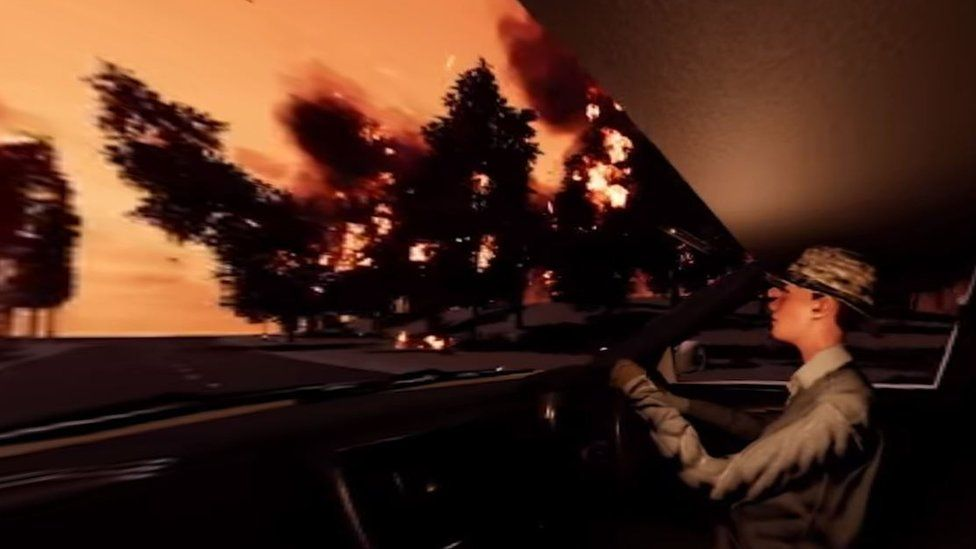 A scene from the simulation shows a tree falling in front of a motorist amid a bushfire
