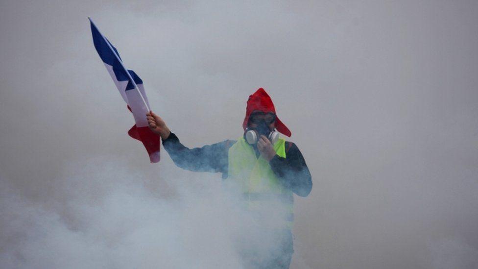 Demonstrator braves tear gas in Paris protest - 1 December