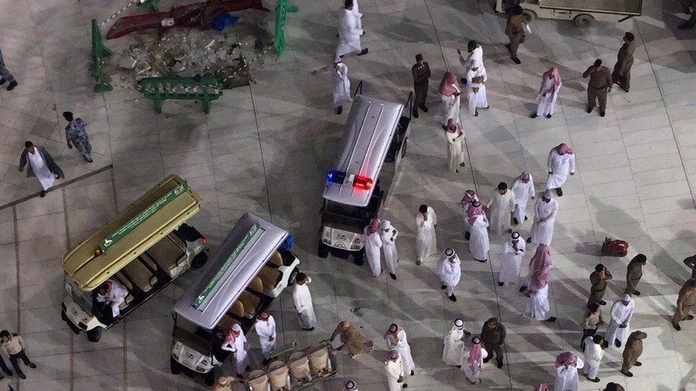 Saudi emergency teams stand inside the Grand Mosque, Mecca, 11 September 2015