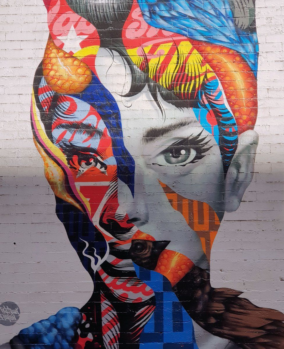 A mural of Audrey Hepburn in Little Italy, New York City