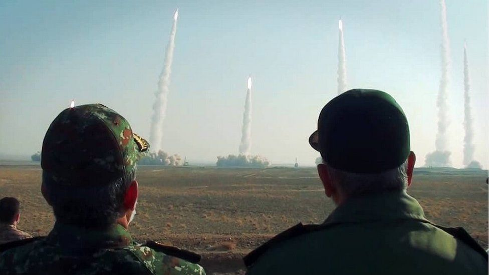 Handout photo shows Iranian Islamic Revolution Guard Corps (IRGC) chief Hossein Salami (R) watching missiles launch during an exercise in Iran (15 January 2021)