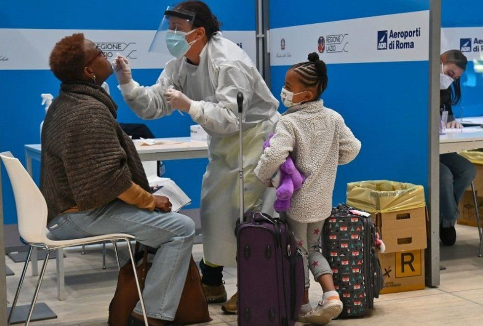 Visitor being tested for Covid-19 at Rome Fiumicino airport, 9 Dec 20