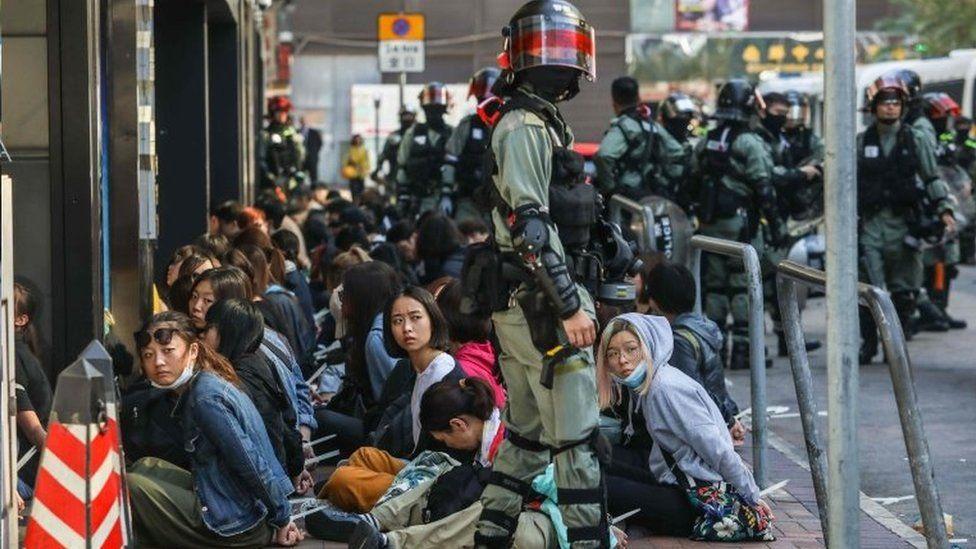 Hong Kong police and students