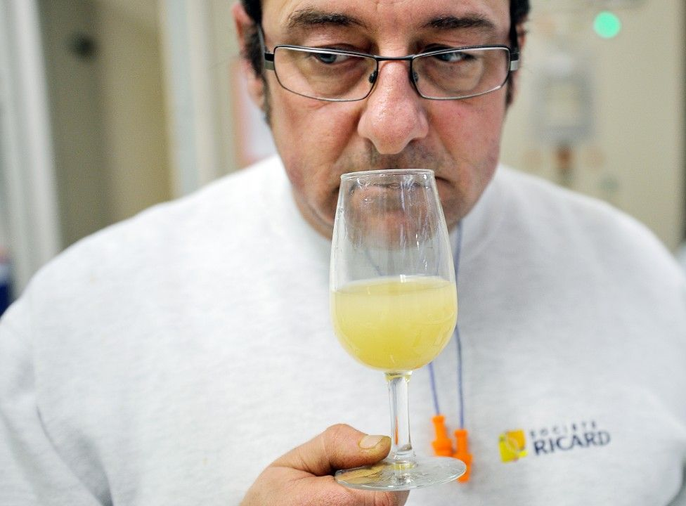 An employee of Pernod Ricard sniffing a glass