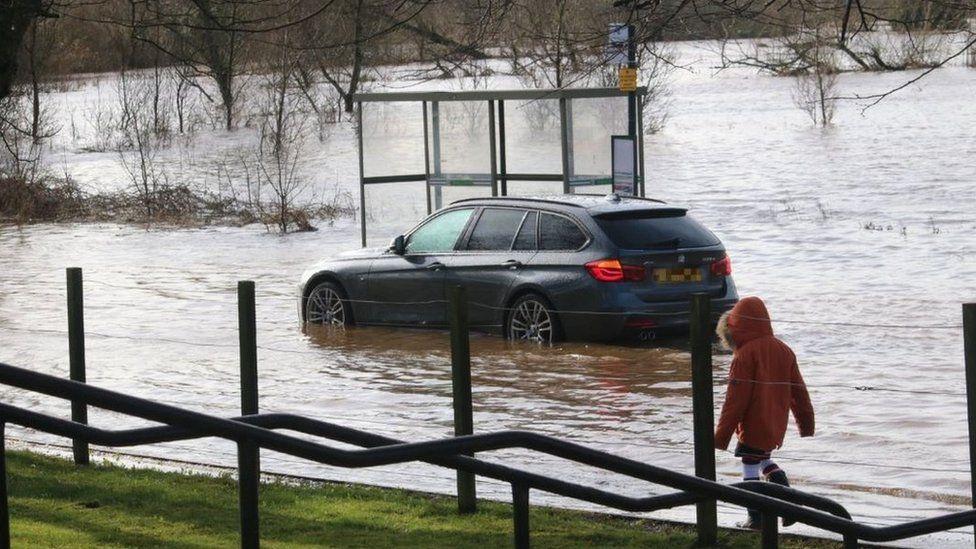 Car in floodwater in Bridge of Allan