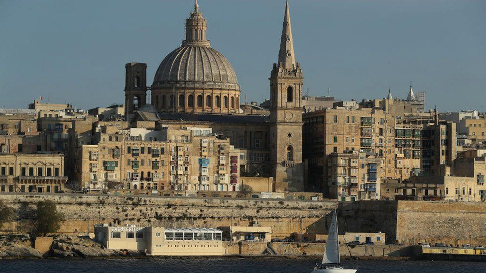 Valletta, including the dome of the Basilica of Our Lady of Mount Carmel, stands on March 29, 2017 as seen from opposite the bay in Sliema, Malta