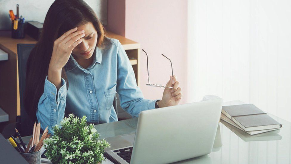 Stressed woman at computer