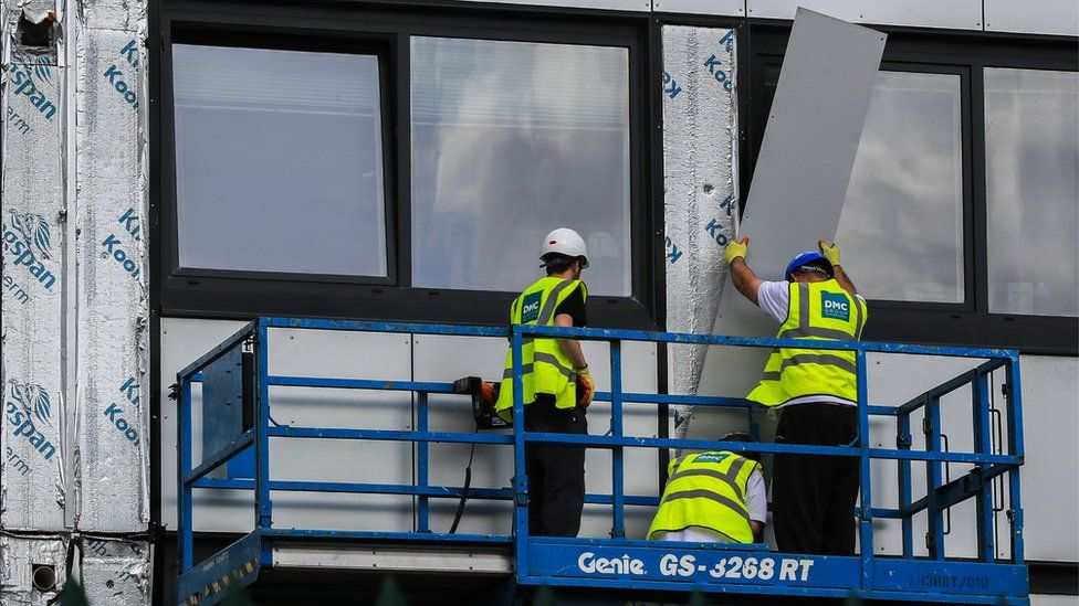 Cladding being removed from a building