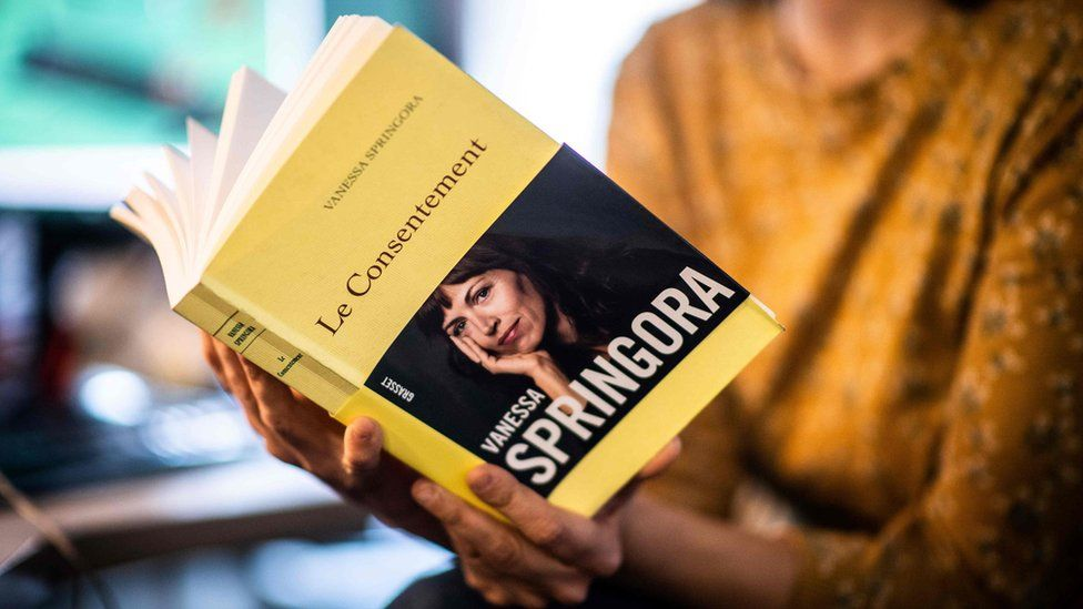 """A woman holds the book """"Le Consentement"""" from French writer Vanessa Springora, in Paris on December 31, 2019"""