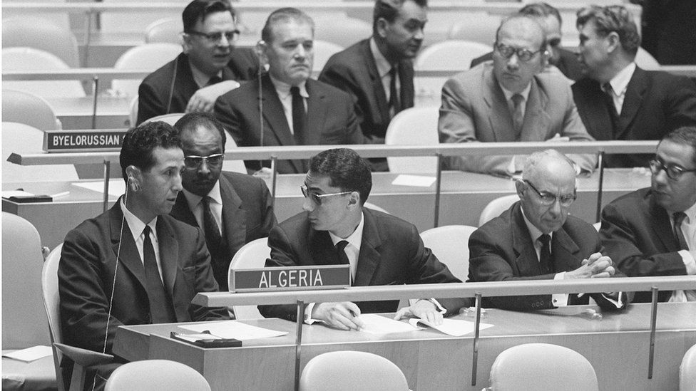 Prime Minister Ahmed Ben Bella (L) and members of the Algerian delegation talk together, United Nations, New York, 10 October 1962.