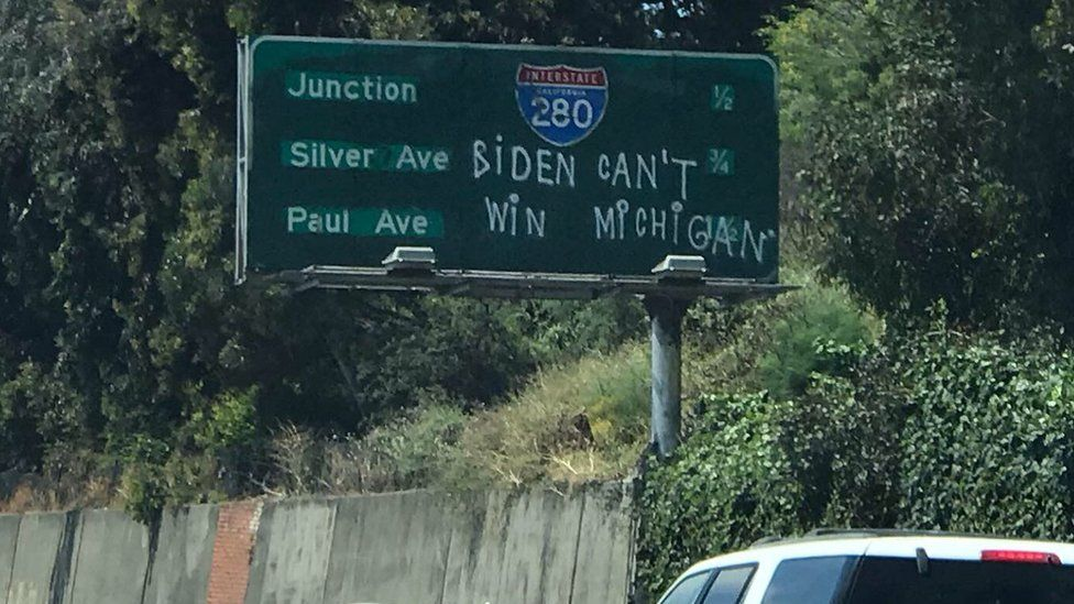 Some anti-Biden graffiti on a San Francisco highway sign.