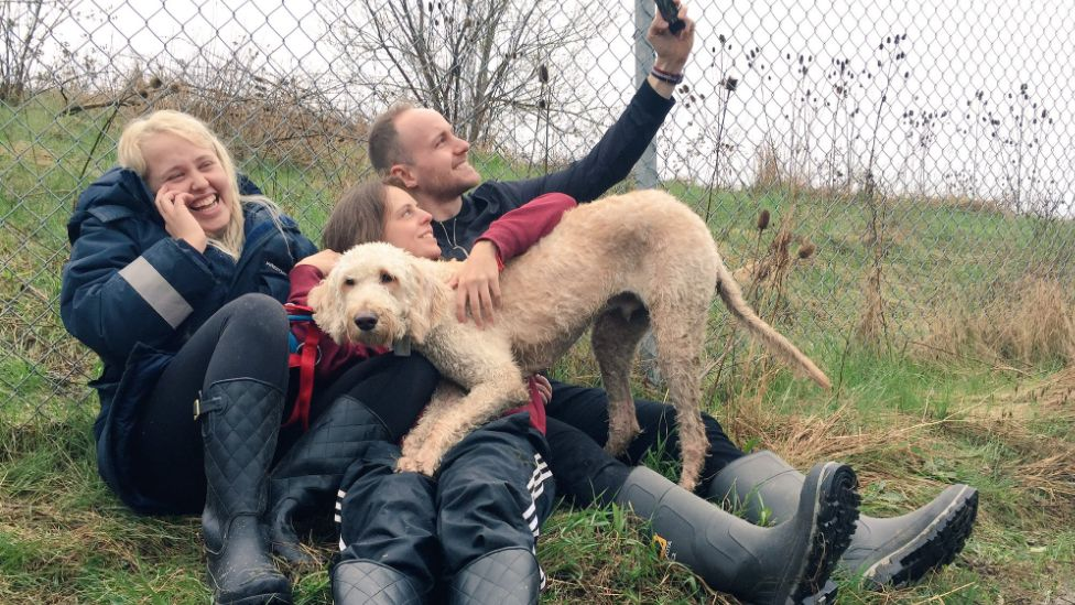 Cooper is reunited with his owner Terri Pittman (centre)