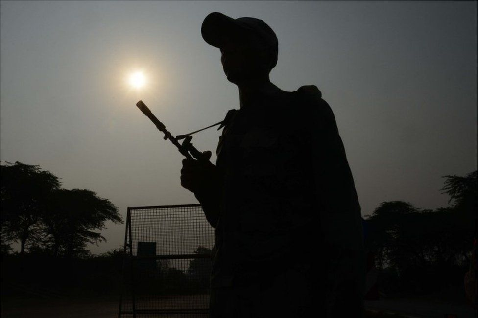 """Indian Border Security Force (BSF) personnel stand guard at the India-Pakistan Wagah Border, about 35 km from Amritsar on September 29, 2016, after the Punjab state government issued a warning to villagers to evacuate from a 10 km radius from the India-Pakistan border. Indian commandos carried out a series of lightning strikes September 29 along the de facto border with Pakistan in Kashmir, provoking furious charges of """"naked aggression"""" from its nuclear-armed neighbour."""
