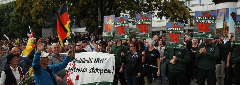Protesters in Chemnitz on 27 August hold signs reading: 'Stop the Asylum Flood!'