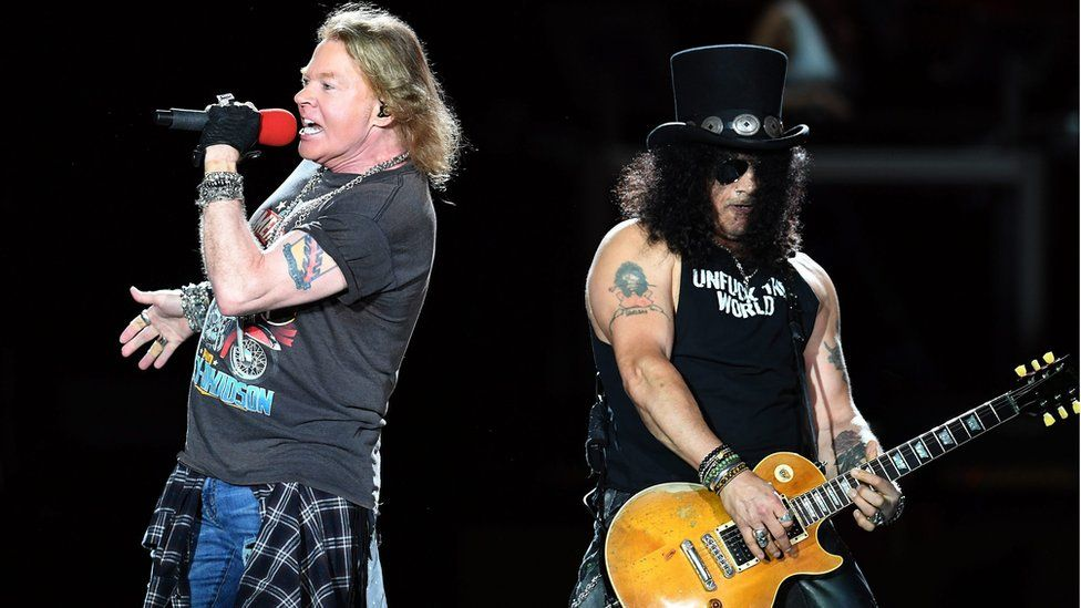 "Lead singer Axl Rose (L) and guitarist Slash (R) of US hard rock band Guns N"" Roses perform in Brisbane, Australia,"