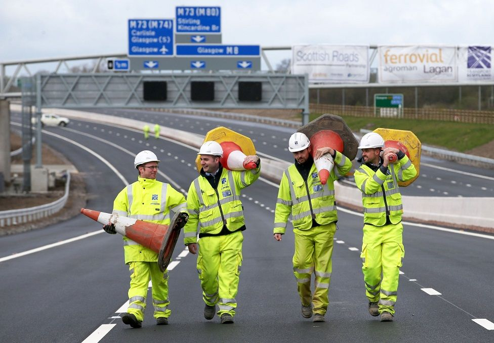 Engineers from Transport Scotland collect the last few cones