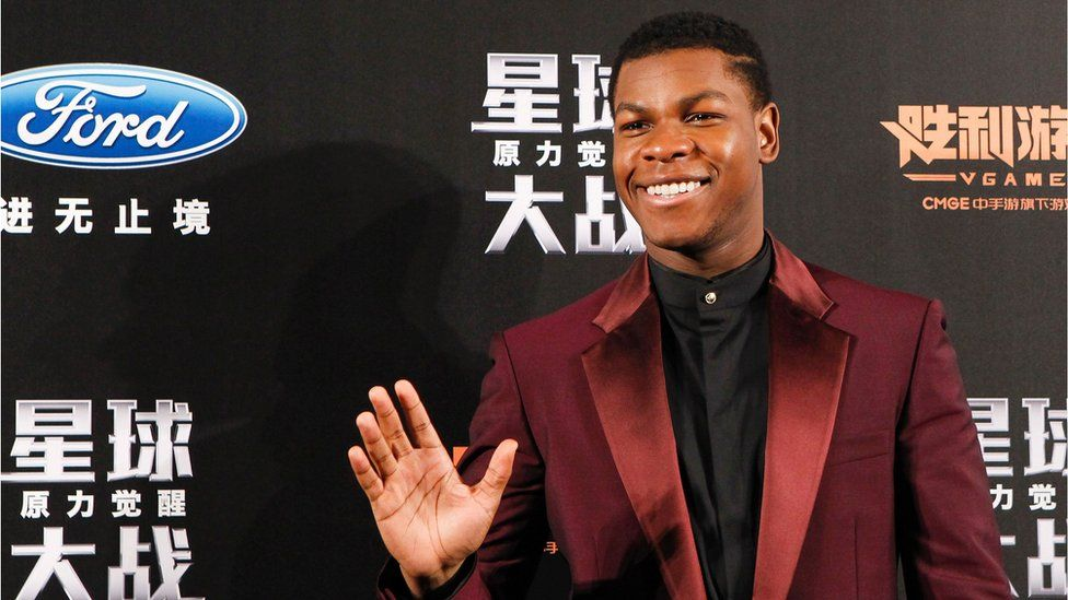 """British actor John Boyega waves to fans during the Shanghai premiere of """"Star Wars: The Force Awakens"""""""