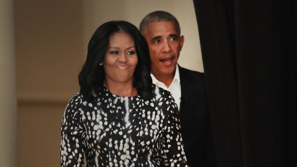 Former President Barack Obama and his wife Michelle arrive for a roundtable discussion at the South Shore Cultural Center in Chicago, Illinois.