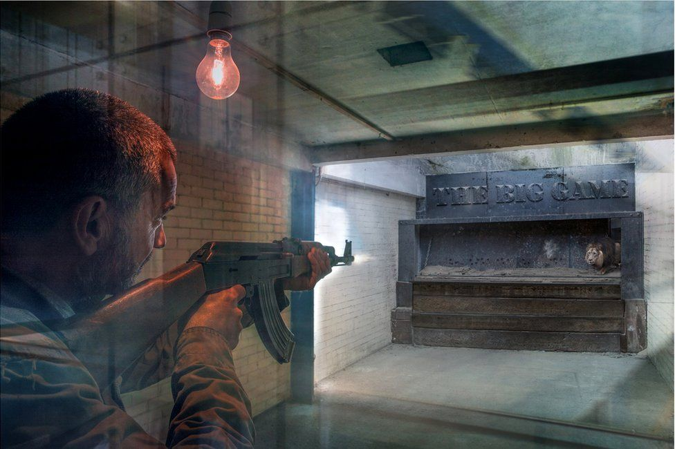 An abstract image of a hunter shooting at a lion in a small enclosed space