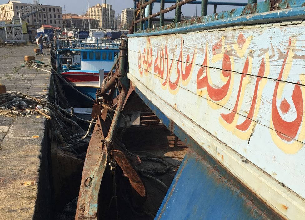 An abandoned Libyan smuggler's boat in the port at Catania