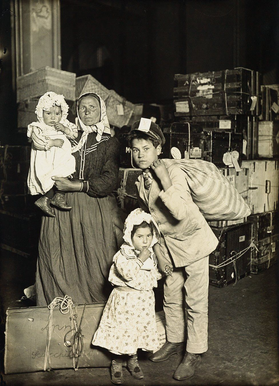 A family together with their bags.