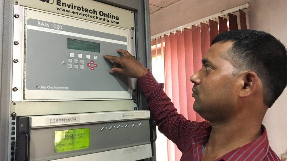 Operator Rajesh Gupta shows the machine that measure PM2.5 in Kanpur