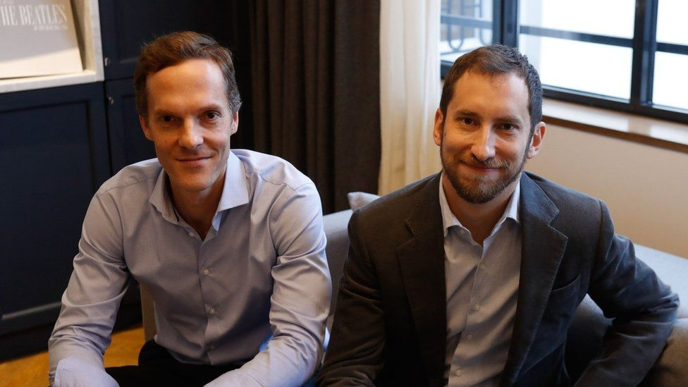 Co-founders of US start-up company Juul, Adam Bowen (L) and James Monsees pose in Paris on december 5, 2018.