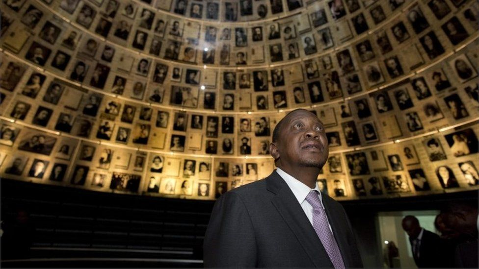 """Uhuru Kenyatta, looks up and around at the photographs in the conical shaped """"Hall of Names"""", during a ceremony to honor the six-million Jews who perished at the hands of the Nazis during the Holocaust of World War II, in the Yad Vashem Holocaust memorial museum in Jerusalem, Israel, 23 February 201"""