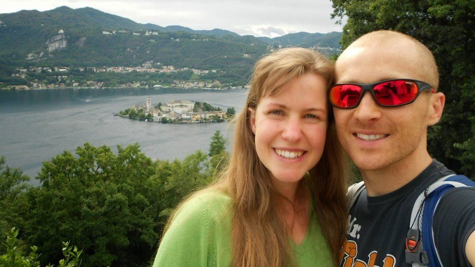 Dan and Esther take a selfie next to a lake