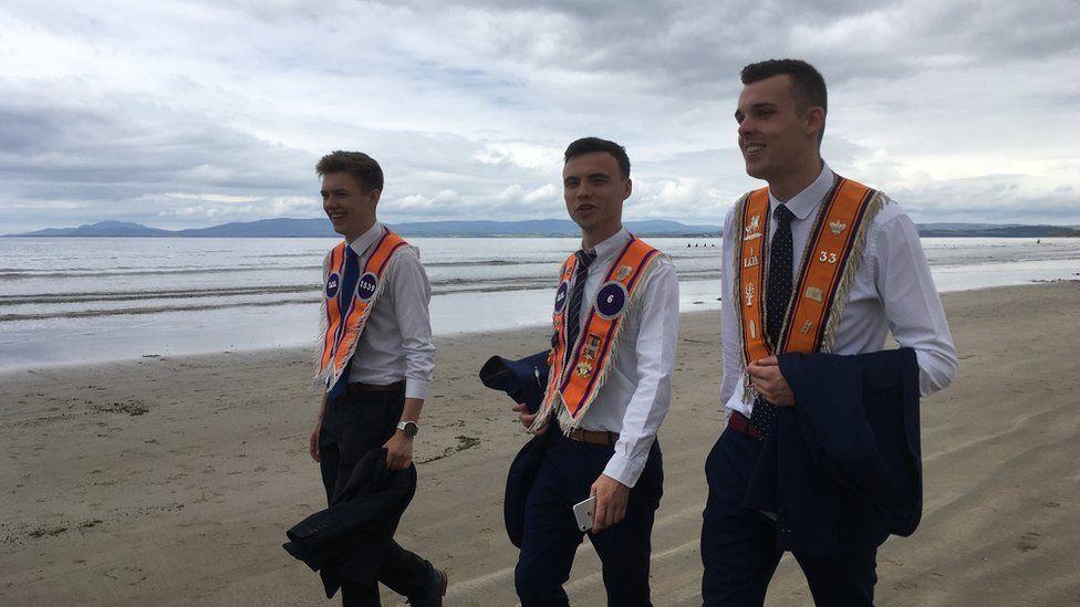 ORANGEMEN ON A BEACH