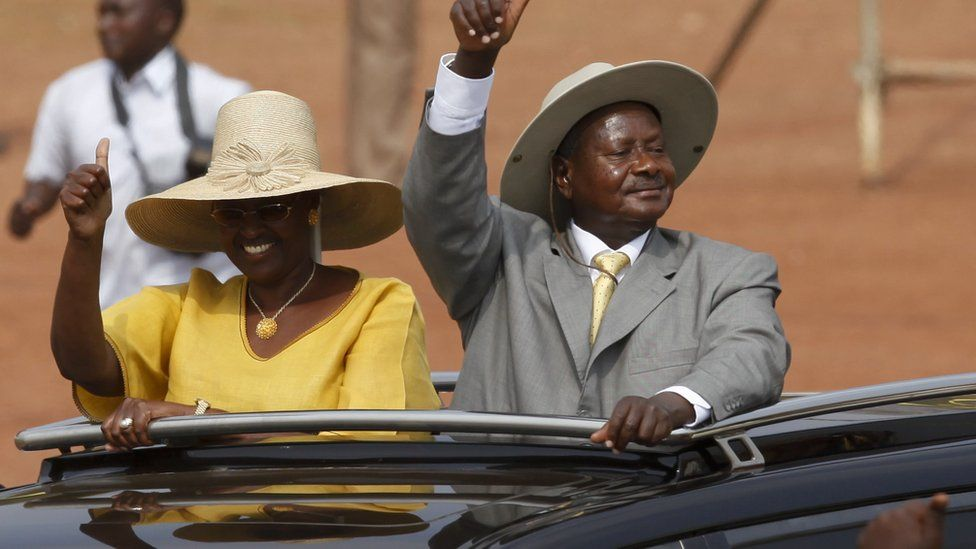 "The leader of Uganda""s ruling NRM President Yoweri Museveni (R) and his wife (L) greets his supporters upon arrival at a rally in the capital Kampala"