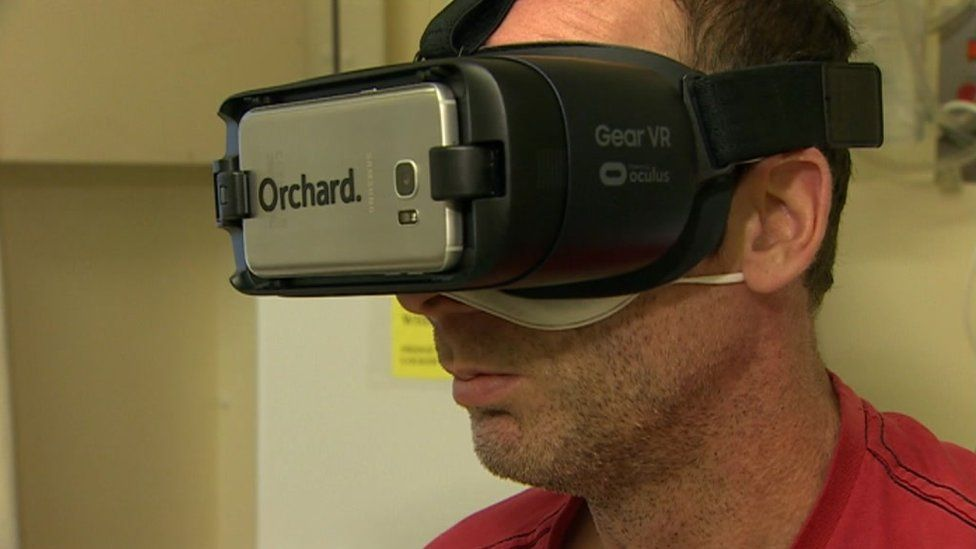 A patient wearing a virtual reality headset