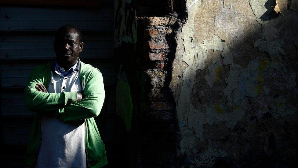 A migrant outside an abandoned building in Rome's Tiburtina district